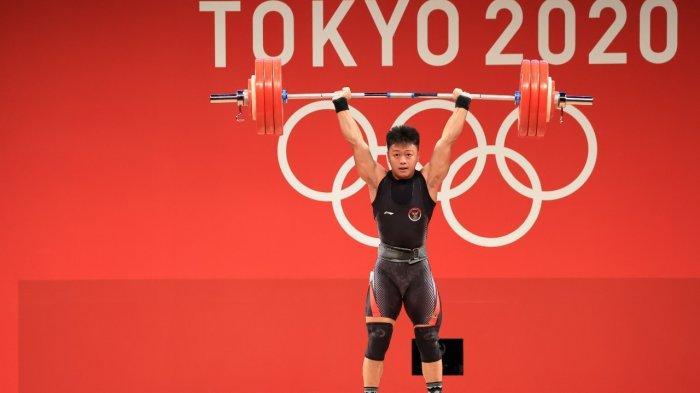 Lifter Indonesia Rahmat Erwin Abdullah sukses meraih medali perunggu di Olimpiade 2020 Tokyo.