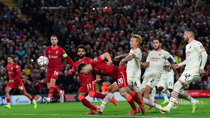 Striker Liverpool asal Portugal Diogo Jota (tengah) menuju gawang selama pertandingan sepak bola Grup B putaran pertama Liga Champions UEFA antara Liverpool dan AC Milan di Anfield di Liverpool, Inggris barat laut pada 15 September 2021. AFP/Paul ELLIS