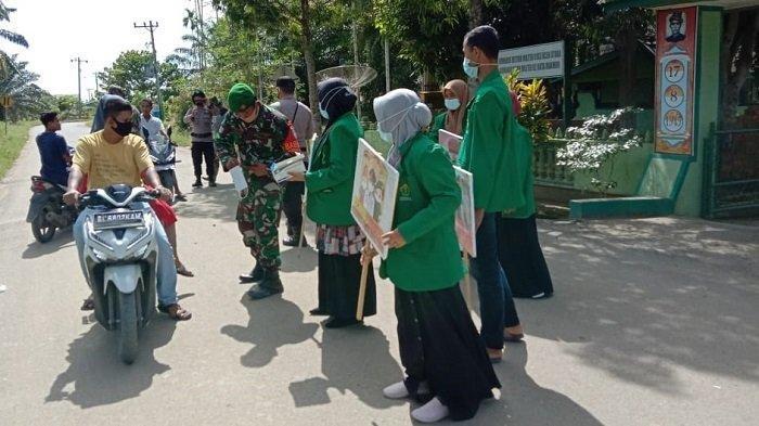 Mahasiswa KKN Bersama TNI/Polri Sosialisasikan Protokol Kesehatan di Aceh Utara