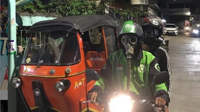 Viral Driver Ojol Pakai Masker Anti-Nuklir untuk Keamanan dari Corona, Benarkah Bisa Tangkal Virus?