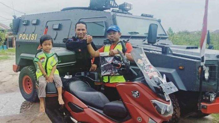Lilik Gunawan Anaknya yang berusia empat tahun Ke Mekkah Kendarai Sepeda Motor, Anggota DPRD Merangin Jambi Sudah Lewati Tiga Negara