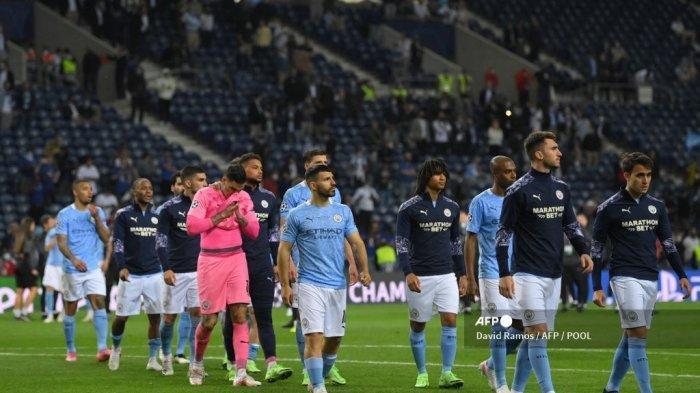 Para pemain Manchester City bereaksi pada akhir pertandingan sepak bola final Liga Champions UEFA antara Manchester City dan Chelsea FC di stadion Dragao di Porto pada 29 Mei 2021.