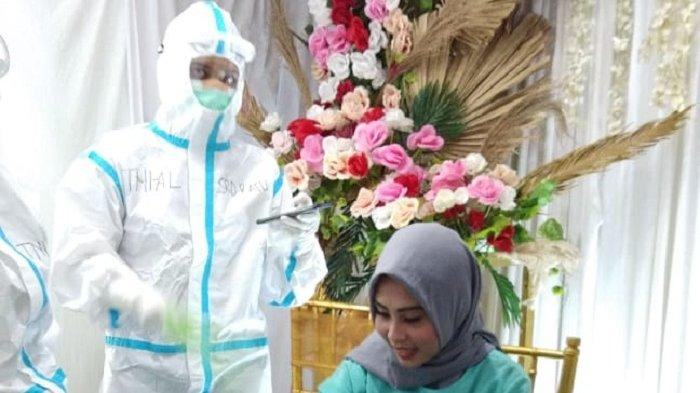 Rumah Sakit Darurat Covid-19 Wisma Atlet Kemayoran (RS Wisma Atlet) Jakarta memfasilitasi pasien covid-19 bernama Aini melangsungkan pernikahan secara virtual, Jumat (1/1/2020). (Istimewa/ Tribunnews.com)