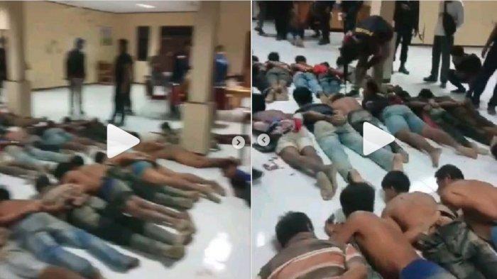 Di media sosial beredar video Muslim cs berada di kantor polisi. Mereka dalam posisi tengkurap berjajar di lantai.