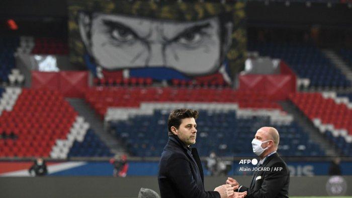 Pelatih Paris Saint-Germain Argentina Mauricio Pochettino menyaksikan pertandingan sepak bola L1 Prancis antara Paris Saint-Germain dan Stade Brestois 29 di stadion Parc des Princes di Paris pada 9 Januari 2021. Alain JOCARD / AFP