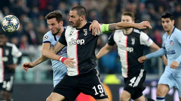 Pemain Atletico Madird, Saul berduel dengan Pemain Juventus Gonzalo Higuain (@atleticodemadrid)