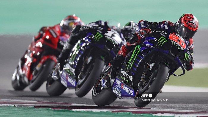 Monster Energy Yamaha MotoGP Pembalap Prancis Fabio Quartararo berkendara selama Moto GP Qatar Grand Prix di Sirkuit Internasional Losail, di kota Lusail pada 28 Maret 2021. KARIM JAAFAR / AFP