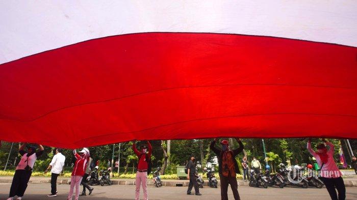 Beredar Video Helikopter Bawa Bendera Merah Putih dan Bendera TNI, Kadispenau: Latihan HUT Ke-76 RI