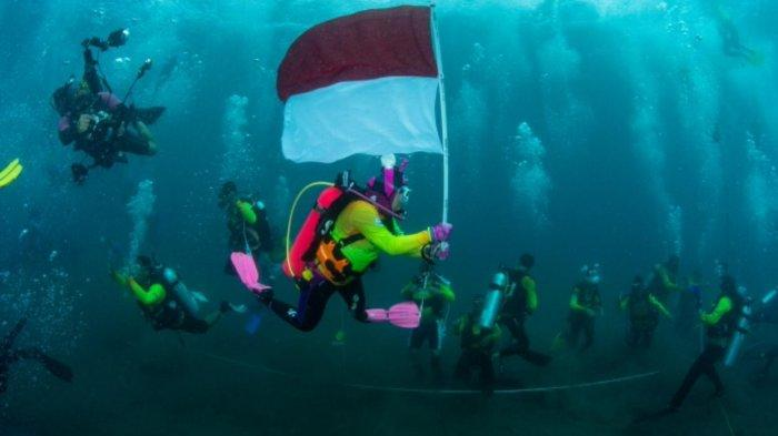 WASI Kibarkan Merah Putih di Dasar Laut Teluk Manado, Tercatat di Guinness World Records