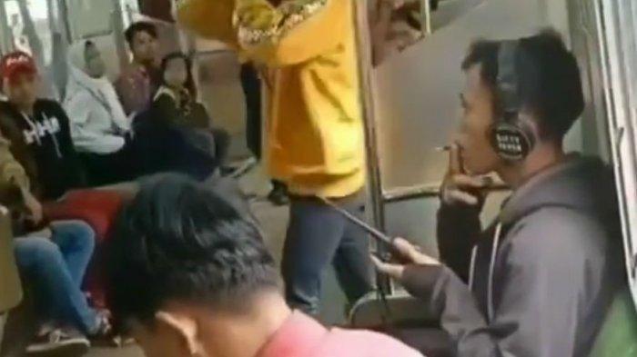 VIRAL Video Penumpang KRL Merokok di Gerbong, Langsung Ditegur dan Diturunkan oleh Petugas