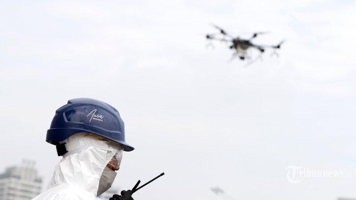 Polisi Malaysia Pakai Drone Untuk Periksa Suhu Tubuh Di Tengah Lonjakan Kasus Covid-19