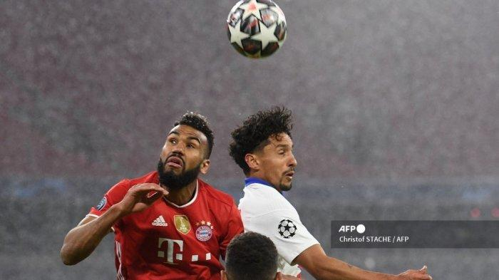 Penyerang Bayern Munich asal Kamerun Eric Maxim Choupo-Moting (kiri) dan bek Paris Saint-Germain asal Brazil Marquinhos sama-sama melompat untuk menyundul bola selama pertandingan sepak bola leg pertama perempat final Liga Champions UEFA antara FC Bayern Munich dan Paris Saint-Germain (PSG) di Munich, Jerman bagian selatan, pada 7 April 2021. Christof STACHE / AFP
