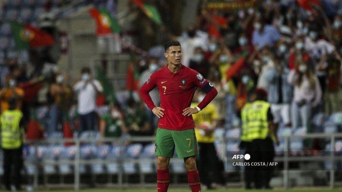 Penyerang Portugal Cristiano Ronaldo bereaksi setelah pertandingan sepak bola Grup A Piala Dunia Qatar 2022 babak kualifikasi Eropa antara Portugal dan Republik Irlandia di stadion Algarve di Loule, dekat Faro, Portugal selatan, pada 1 September 2021. CARLOS COSTA / AFP