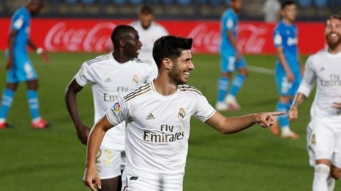 Penyerang Real Madrid, Marco Asensio, merayakan golnya ke gawang Valencia dalam laga di Stadion Alfredo Di Stefano, Kamis (18/6/2020).