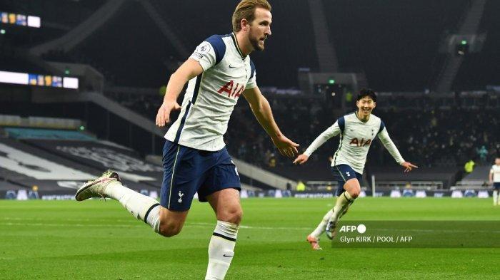 Striker Tottenham Hotspur Inggris Harry Kane merayakan mencetak gol kedua timnya selama pertandingan sepak bola Liga Premier Inggris antara Tottenham Hotspur dan Arsenal di Stadion Tottenham Hotspur di London, pada 6 Desember 2020. Glyn KIRK / POOL / AFP