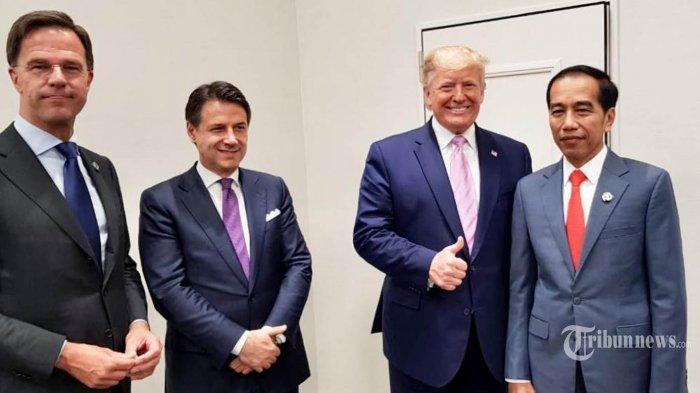 Presiden Indonesia Joko Widodo berfoto dengan Presiden Amerika Serikat Donald Trump dan para pemimpin dunia yang tengah mengikuti Konferensi Tingkat Tinggi (KTT) G20 di Jepang, Jumat (28/6/2019). TRIBUNNEWS/HO/BIRO PERS