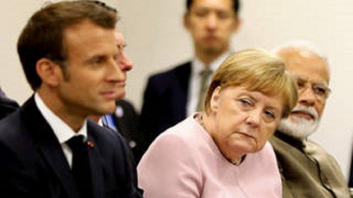 Presiden Prancis Emmanuel Macron dan Kanselir Jerman Angela Merkel saat menghadiri KTT G20 di Osaka, Jepang, 29 Juni 2019.