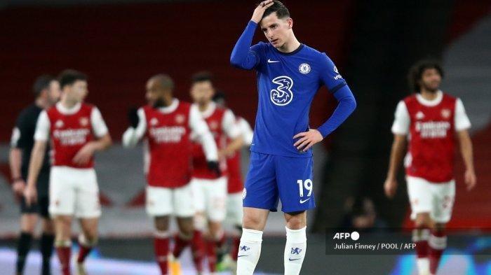 Reaksi gelandang Chelsea asal Inggris, Mason Mount, setelah Arsenal mencetak gol ketiga mereka dalam pertandingan sepak bola Liga Primer Inggris antara Arsenal dan Chelsea di Emirates Stadium, London pada 26 Desember 2020. JULIAN FINNEY / POOL / AFP