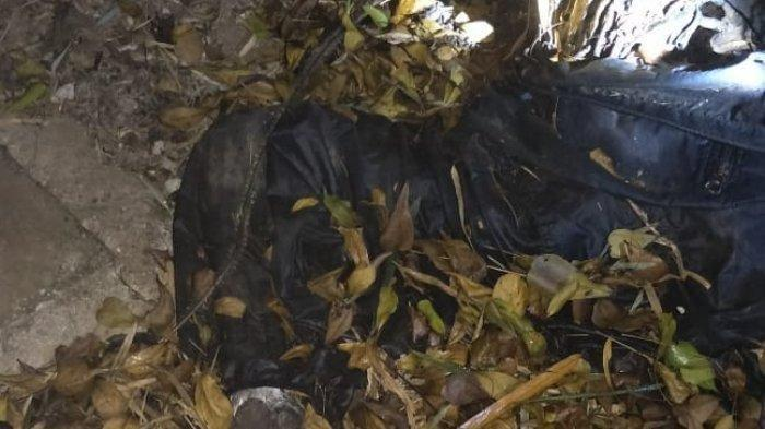 Sesosok jenazah ditemukan yang bagian kepalanya terbelah, ditemukan di pinggir sungai Cisadane, tepatnya di Jalan Gading Golf Boulevard, Cihuni, Pagedangan, Kabupaten Tangerang, pada Minggu malam (21/4/2019).