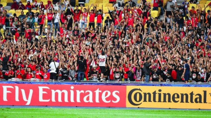 Suporter Indonesia mendukung Timnas U-16 Indonesia Vs Iran di Stadion Nasional Bukit Jalil, Malaysia pada Jumat (21/9/2018).