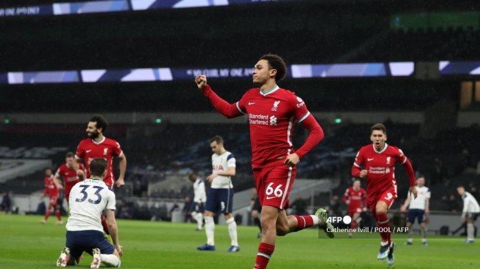 Bek Inggris Liverpool Trent Alexander-Arnold merayakan gol kedua mereka selama pertandingan sepak bola Liga Premier Inggris antara Tottenham Hotspur dan Liverpool di Tottenham Hotspur Stadium di London, pada 28 Januari 2021. Catherine Ivill / POOL / AFP