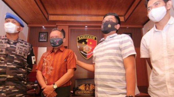 Pelaku inisial BN (50) warga Balikpapan saat menyerahkan diri di Satreskrim Polresta Balikpapan, Rabu (28/4/2021).
