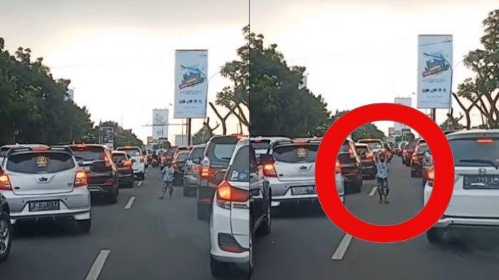 viral aksi bocah buka akses jalan untuk ambulans di tengah kemacetan, begini cerita lengkapnya.