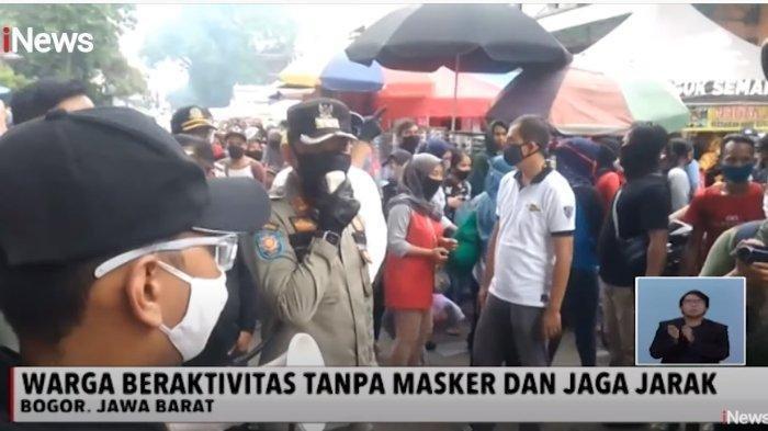 Wali Kota Bogor, Bima Arya turun langsung menegur warga dan pedagang yang berkerumun di Pasar Anyar.