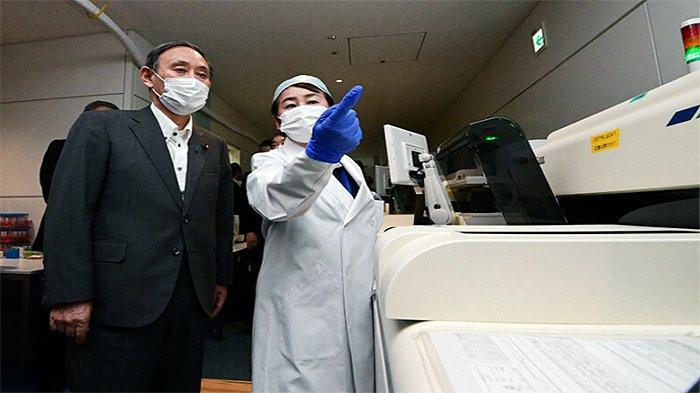 Laporan Nomura Research Institute terkait Covid-19 Jadi Bahan Konferensi Pers PM Jepang