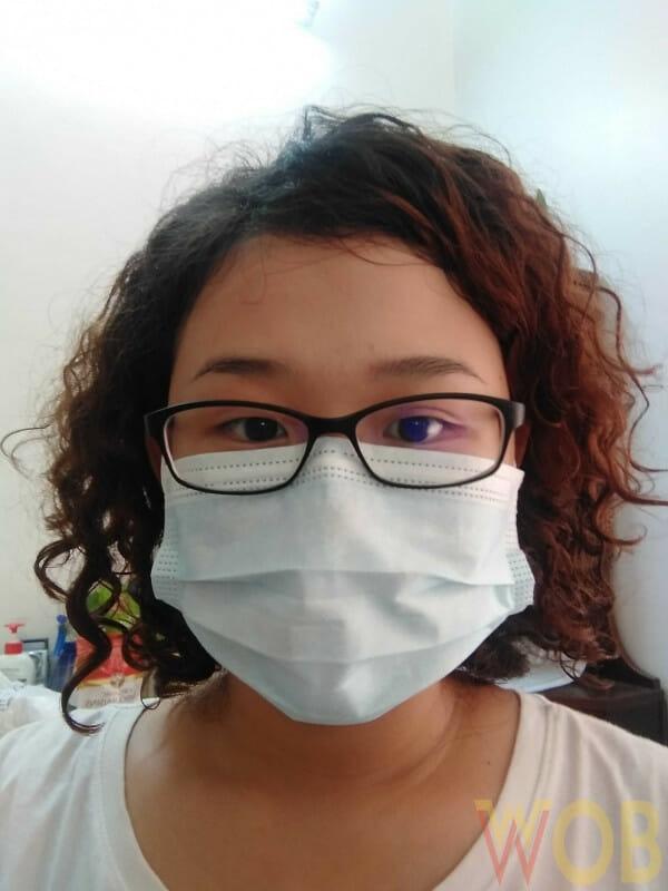 tarik masker Anda lebih tinggi ke atas batang hidung