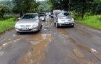 20140121_120436_jalan-lenteng-agung-jakarta-rusak-akibat-hujan.jpg