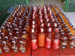 228-botol-miras-ilegal-diamankan-satgas-pamtas-ri-png-yonif-411_20200103_233623.jpg