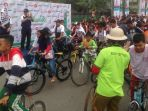 ajang-sosialisasi-asian-para-games-2018-di-pontianak-diramaikan-ribuan-peserta-sepeda-nusantara_20180930_223146.jpg