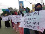 aksi-solidaritas-dari-pemuda-muslim-di-kota-palu-untuk-korban-penembakan-di-selandia-baru.jpg