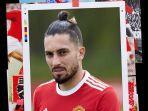 alex-telles-mengenakan-jersey-baru-manchester-united-musim-20212022.jpg