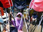 anak-bantu-orang-tua-berjualan-masker-kain_20200415_224111.jpg