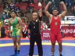 ashar-ramadhan-juara-kelas-97kg-pon-xx-papua.jpg