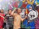asyiknya-kampoeng-jadoel-di-rejomulyo-dinding-dan-tembok-jalan-dipenuhi-lukisan-batik_20170408_214233.jpg