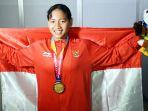 atlet-para-swimming-syuci-indriani-raih-emas-1_20181009_021415.jpg