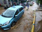 banjir-di-jalan-cikutra-barat-kota-bandung_20181127_174255.jpg