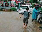 banjir-di-jalan-grogol-limo-depok-di-depan-spbu_20170221_121056.jpg
