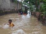 banjir-kampung-petir-tangerang_20160301_161038.jpg