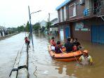 banjir-landa-tangerang-selatan_20200101_201653.jpg
