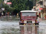 banjir-melumpuhkan-akses-jalan-kartini_20200102_211445.jpg