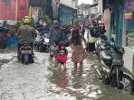 banjir-merendam-di-kawasan-rawa-buaya_20210216_220537.jpg