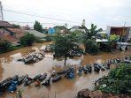 banjir-rendam-sejumlah-kawasan-di-jakarta-timur_20200101_205705.jpg