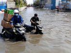 banjir-rob-muara-baru-di-tengah-pandemi-covid-19_20200604_182535.jpg