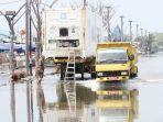banjir-rob-muara-baru_20180201_170303.jpg