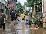 banjir-yang-menggenangi-daerah-cipinang-melayu-323.jpg
