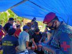 batalyon-kesehatan-tni-bantu-pengobatan-korban-gempa-sulbar_20210118_230253.jpg